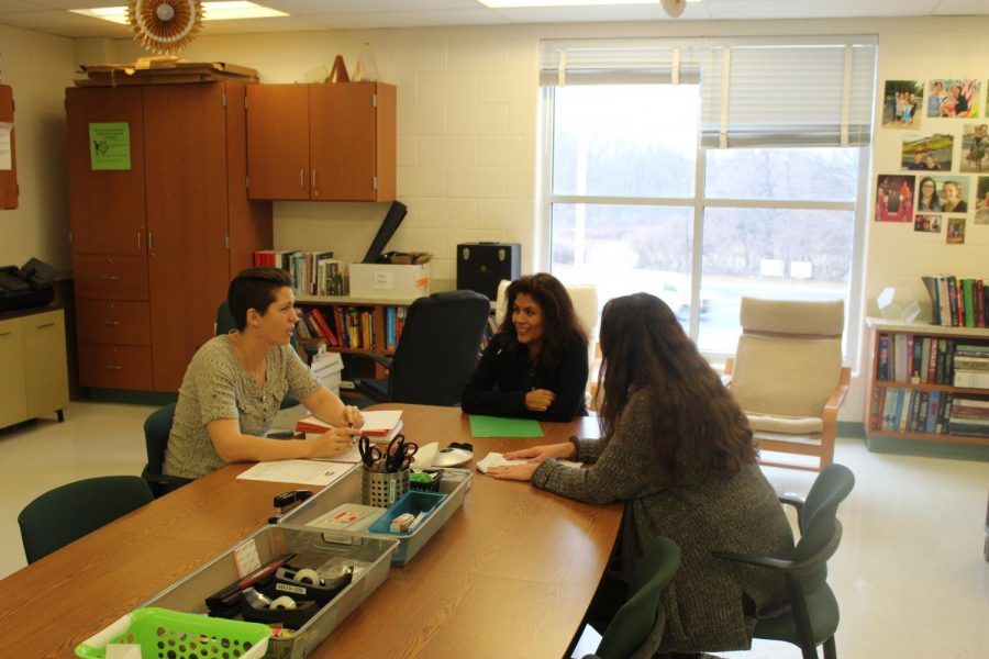 Three math teachers have a discussion their department office during third period. When teaches are not in their class, they are often in their break room.