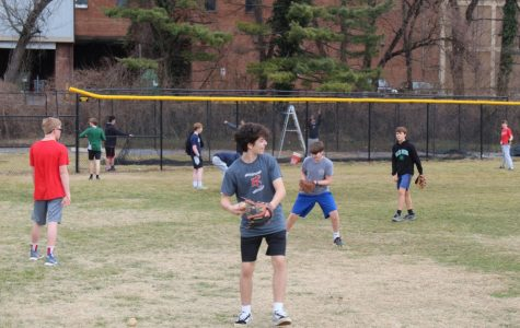 Boys baseball practices throwing as they prepare for their upcoming spring season. The team looks to continue their success from last season.