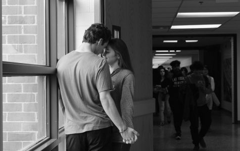 Two students steal time to rekindle their romance. While this choice is favored by the couple, not all passer-bys appreciate the PDA.