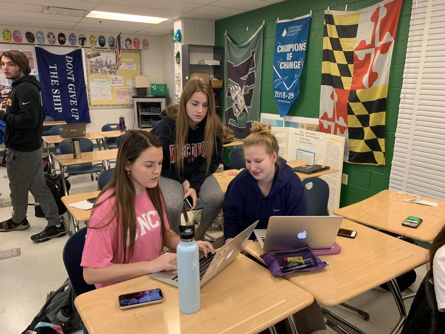 Seniors Meghan Rinehart, Geneva Smith and Leah Bregman (left to right) hard at work planning this year's Bachelors event. The fundraiser hopes to raise money for Pennies for Patients through date auctions.