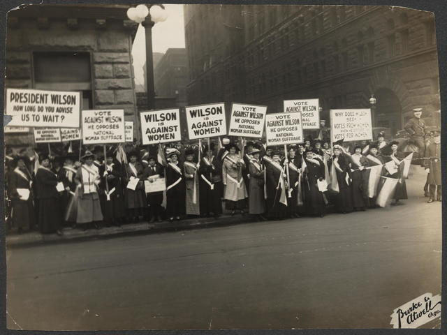 In+1916%2C+Suffragists+protest+outside+Woodrow+Wilson%27s+meeting+in+Chicago+for+the+right+for+women+to+vote.+The+ratification+of+the+19th+amendment+took+72+years+of+non-violent+protest.