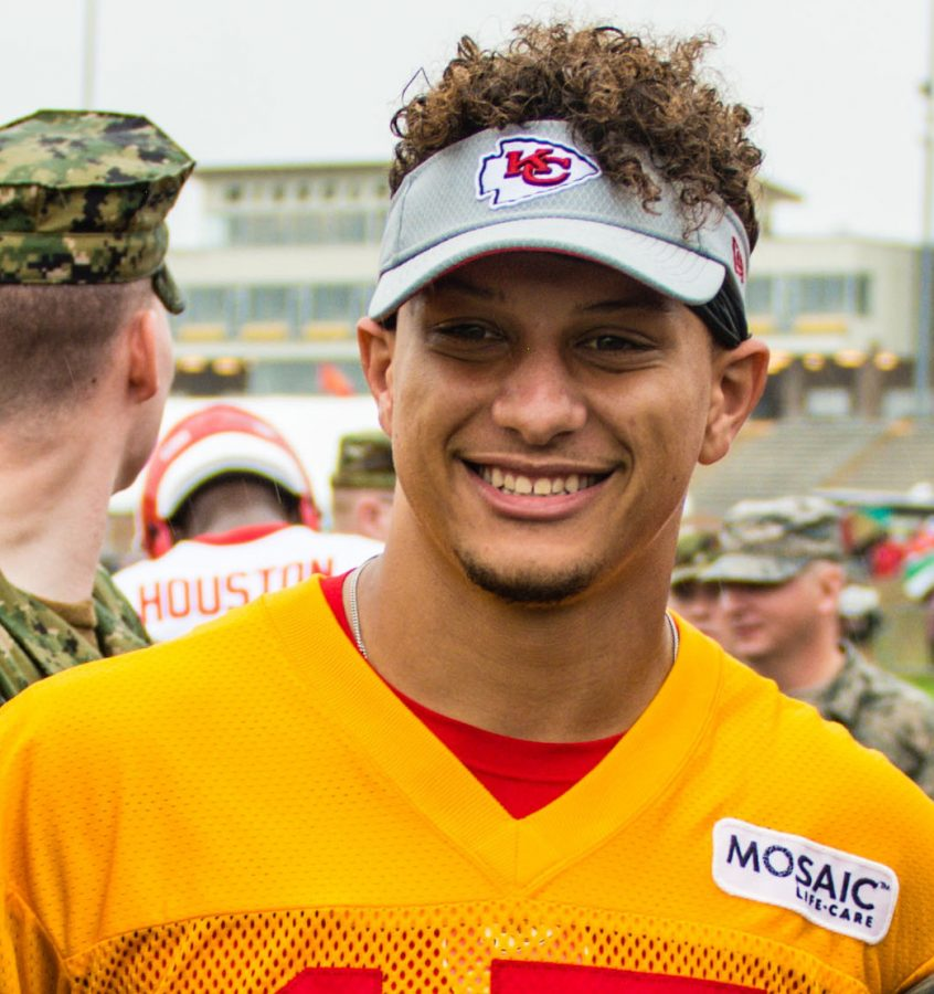 Members of the 139th Airlift Wing, Missouri Air National Guard, pose for a photo with Patrick Mahomes, quarterback for the Kansas City Chiefs football team, at the Chief's training camp in St. Joseph, Mo., Aug. 14, 2018. The Chiefs hosted a military appreciation day on their final day of training. (U.S. Air National Guard photo by Master Sgt. Michael Crane)