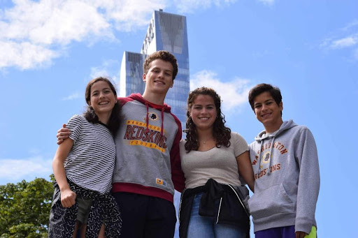 Rachel (class of 24), senior Thomas, class of 17 alum Margaret and sophomore Alex enjoy a beautiful day in New York City this past summer. Theyve all maintained close bonds with each other.