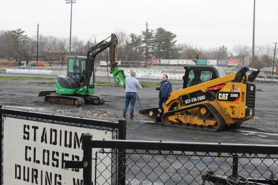 Construction workers discuss the nest step in replacing the turf. In the meantime, the stadium is closed off until the construction is finished. The construction  has caused many inconveniences for students, especially because it is closed off an entrance from Democracy Blvd.