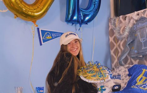Senior Olivia Tetrault's friends threw her a bed party after she committed to the University of Delaware. Her friends brought school apparel and Delaware themed treats to celebrate her big decision.