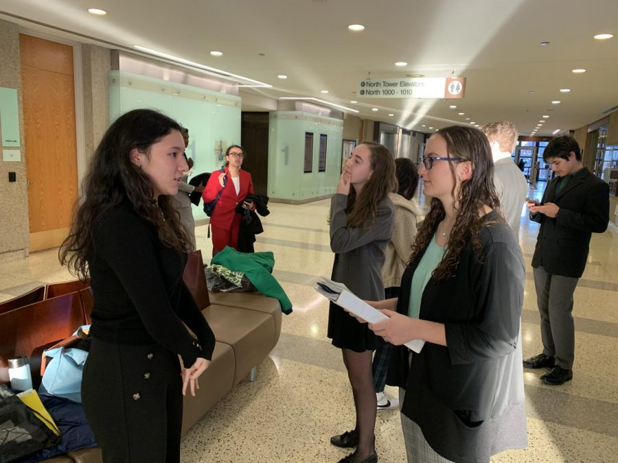Junior Mia Chai is prepping with her lawyers, juniors Emmie Maisel and Danielle Nevett during a break in their trial. Simmon's team concluded their season by making it to the second round of the playoffs.