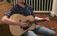 Joey Wolf is a home schooled senior who lives in Silver Spring. Wolf is taught by his mom and enjoys playing his guitar.