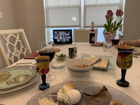 The Renbaum Family celebrates Passover at their home, but have a computer open with their cousins on the screen. Due to COVID-19, Passover seders were held over Zoom to spend it with family across the country.