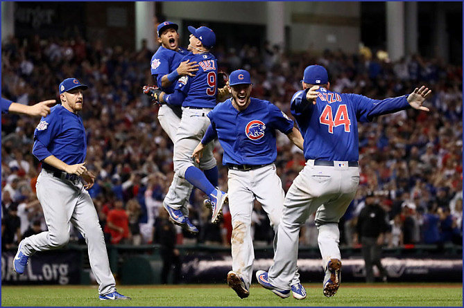 The+Cubs+celebrate+after+overcoming+a+3-1+series+deficit+to+win+their+first+World+Series+in+over+100+years.+This+classic+game+seven+in+Cleveland+is+among+some+of+the+top+sports+games+that+fans+should+watch+again+while+stuck+at+home.