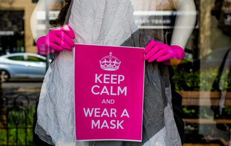 A sign advising people to wear face masks is displayed in a front of a Bethesda store. With cases rising in Maryland, Governor Hogan ordered residents to wear masks at all statewide stores.