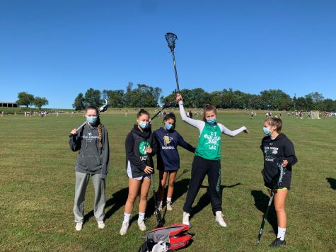 Staying COVID safe, WJ girls lacrosse gets ready to warm up for their Sunday morning game. The girls went on to win 11-6.