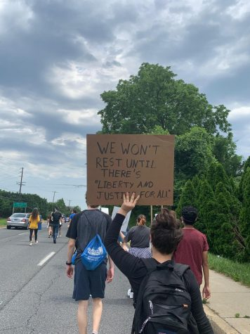 Students march down Old Georgetown Road protesting for police and criminal justice reform.