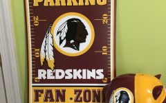 Sophomore Caleb Kasten's desk is still filled with Washington Redskins collector items. The 2020 name change to the