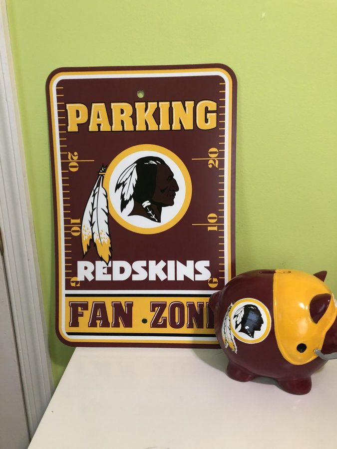 Sophomore Caleb Kastens desk is still filled with Washington Redskins collector items. The 2020 name change to the Washington Football Team has transitioned the historic Native American logo into the letter W.