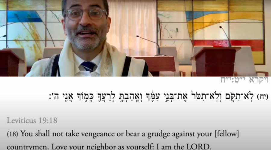 Rabbi+Gil+Steinlauf+delivers+his+Rosh+Hashanah+sermon+over+Zoom.+In+order+to+save+time+and+technical+difficulties%2C+Steinlauf+pre-recorded+his+sermon%2C+which+also+allowed+for+the+texts+he+referenced+to+show+up+on+the+screen.
