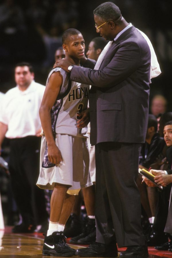 Coach Thompson (right) consoles Hall of Famer Allen Iverson (left) during a game.