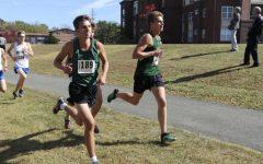 Junior Andrew Schell and Senior Alex Scott running at last year's Cross Country County Meet.
