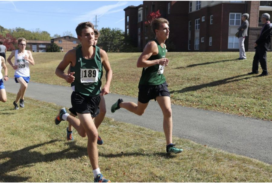 Junior Andrew Schell and Senior Alex Scott running at last year's Cross Country County Meet.