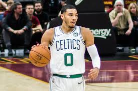 Celtics forward Jayson Tatum takes the ball down the court. Tatum looks to lead the Boston to their first NBA championship win since 2008.