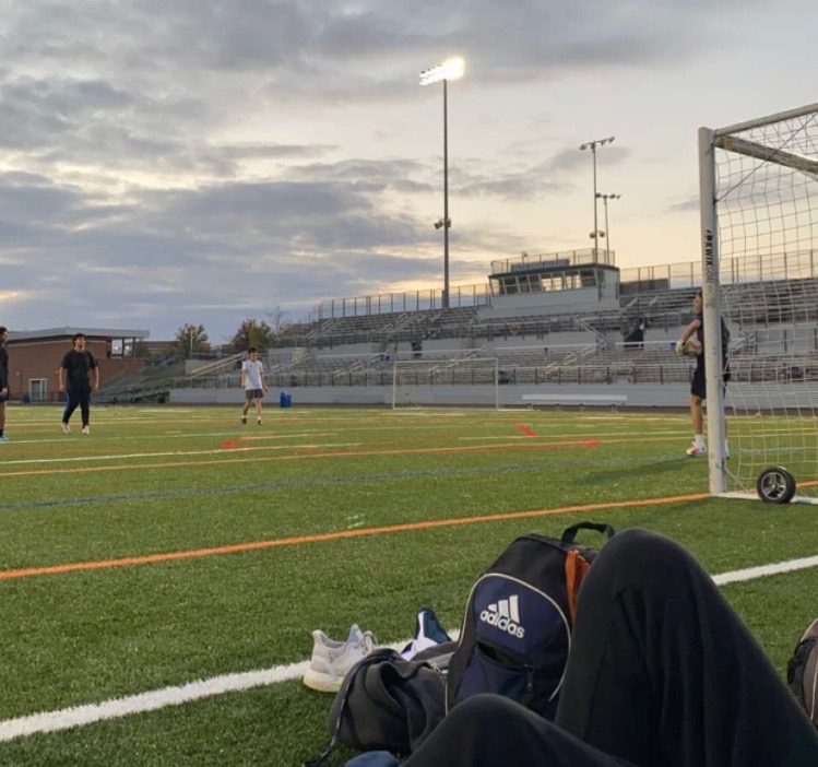Seniors Marcos Gregorio (left), Ben Files (middle) and Aidan Carr (right) routinely play soccer along with other seniors on Friday or Saturday nights. The new field allows a great place for athletes to train on their own time.