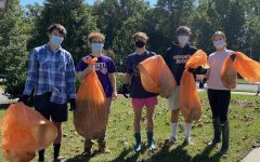 (From left) Juniors Caeden Babcock, David Bowers, Charley Carr, Will Wise and Sophia Carrasco pose with trash collected from a Rockville stream. Members of the Go Green club partake in many local volunteer activities to better the environment.