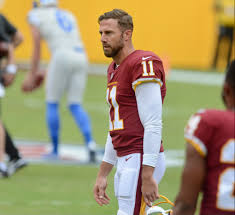 Alex Smith watches on during pregame warm-ups as he unknowingly prepares for what will be his first game with playing time since his leg injury in 2018. He has since then led Washington to a 5-7 record and second place spot in the division.