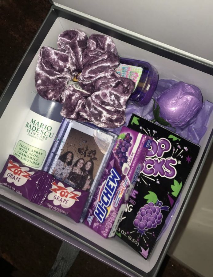 A purple themed gift basket. Not only is it easy to make, but it's also creative and pleasing to the eye.