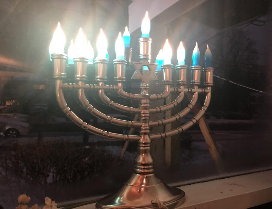 An electric Hanukkiah stands on a windowsill on the sixth night of Hanukkah. The Jewish holiday last for eight days and eight nights.