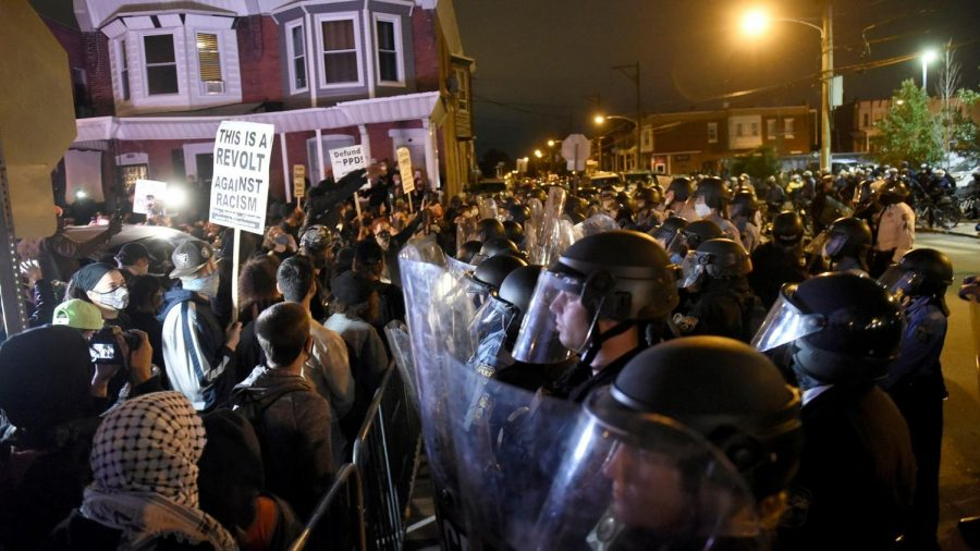 Philadelphia police, donning riot gear, attempt to contain protesters five night before the election.