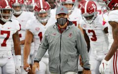 Alabama head coach Nick Saban leads his team onto the field during a pandemic.