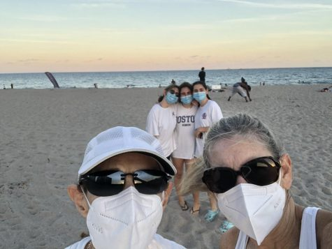 "Junior Becca Scherr and her family went to Florida for Winter Break. They are kept their masks on and a social distance from others for the picture. ""Even though we can"