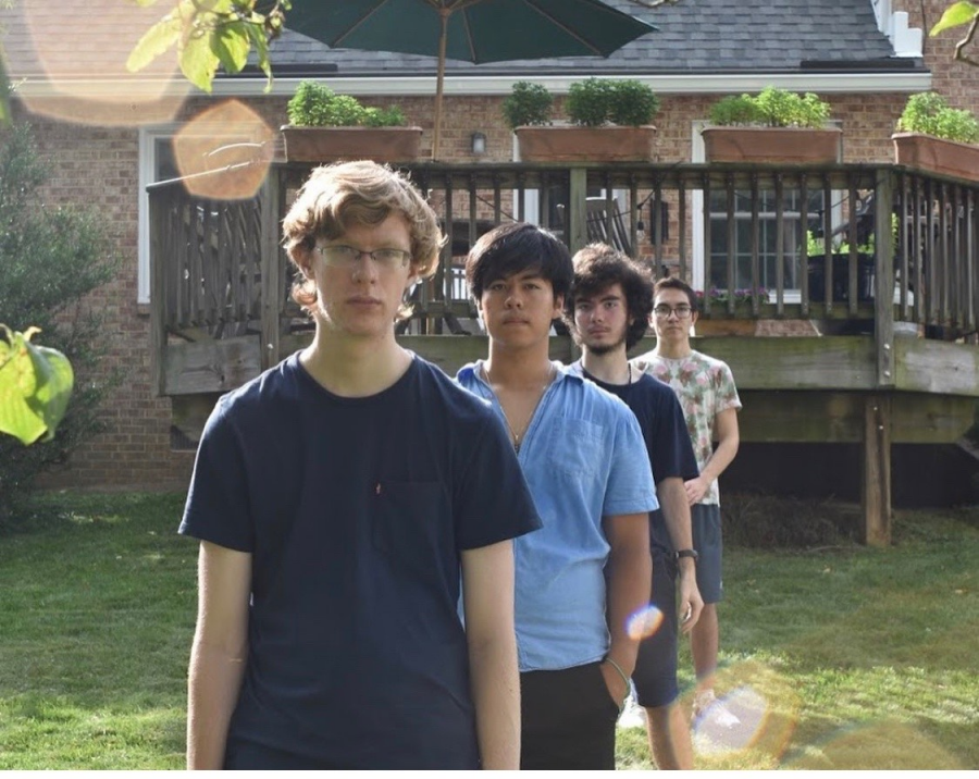 The photo depicts the members of Razzberry, from left to right, seniors Matt Labauch, Henry Sheppard, John Yeakly, and Keith Wagner. The group has been together since middle school.