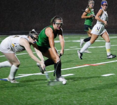 Senior Ellie Poersch fights for the ball in a senior night match up against BCC. Poersch has been on the team since her freshman year, and will miss the spirited game days the most.