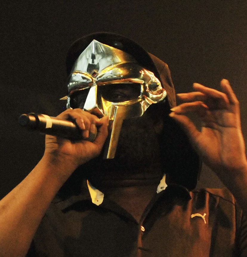 Daniel Dumile (MF DOOM) performing on-stage in his coveted and unmistakable metal mask.
