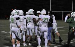 Senior football player Daniel Ticktin huddles to talk with his teammates.   Ticktin has been playing football for WJ since his freshman year of high school. ¨My favorite part of playing football at WJ is the sense of family that we all have,