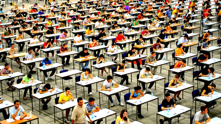 Students+crowd+into+mass+test+taking+halls+to+participate+in+standardized+testing.