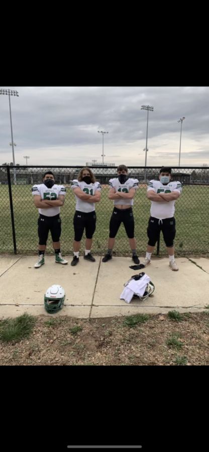 After being named captains for the 2021 football season, WJ players Anthony Villacis, Danny Ticktin, Will Gardner and Chris Ramirez gather to take a photo. They will serve as captains for the shortened two game season.