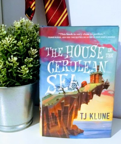 The House in the Cerulean sea, by TJ Klune, is a heartwarming tale of found-family and overcoming prejudice. In this stunning novel filled with magic, laughs and love Klune envelopes you in a hung (in the form of a book).