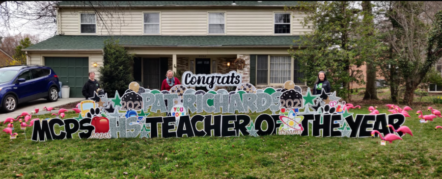 Members of the science department flock Pat Richards lawn in celebration of her teacher of the year award. Richards was thrilled by her colleagues' gesture and the award itself.