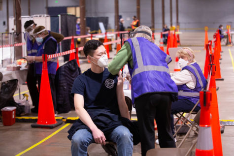 A person receives a dose of the COVID-19 vaccine at a vaccination site in Baltimore, MD. As all Americans 16 and older will be eligible for the COVID-19 vaccine by April 19, younger people are becoming increasingly eager for a vaccine to be approved for their age range