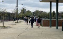 WJ students walk to the school stadium to have lunch outdoors on April 12. The experience of returning to in-person learning has been unique to every person.
