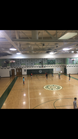 WJ students enjoy basketball during gym class.