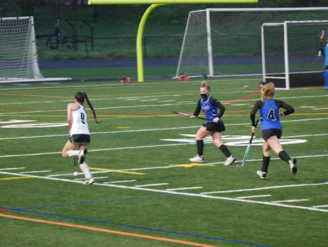 Forward Kate Aschenbach (9) brings the ball up field for an offensive possession.
