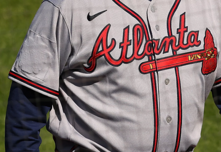 The 2021 All-Star Game patch is still slightly visible on the sleeve of Braves manager Brian Snitkers jersey.