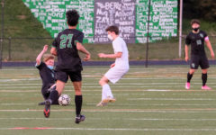 Sophomore Nick Avillo slides in for a tackle and regains possession for the Wildcats.