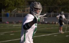 Luke Dentel prepares for a faceoff on the wing in a home game against Wooton HS on May 14.