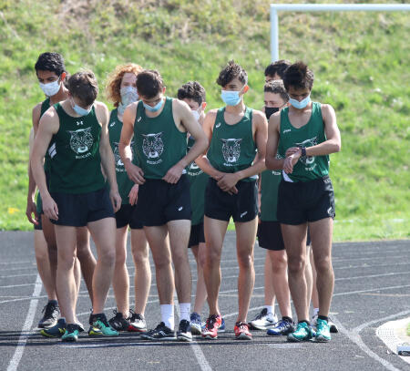 The team lines up in preparation for their race. Alex Scott (far left) and Adam Morad (far right) have been stand outs this season, consistently performing well in their meets.