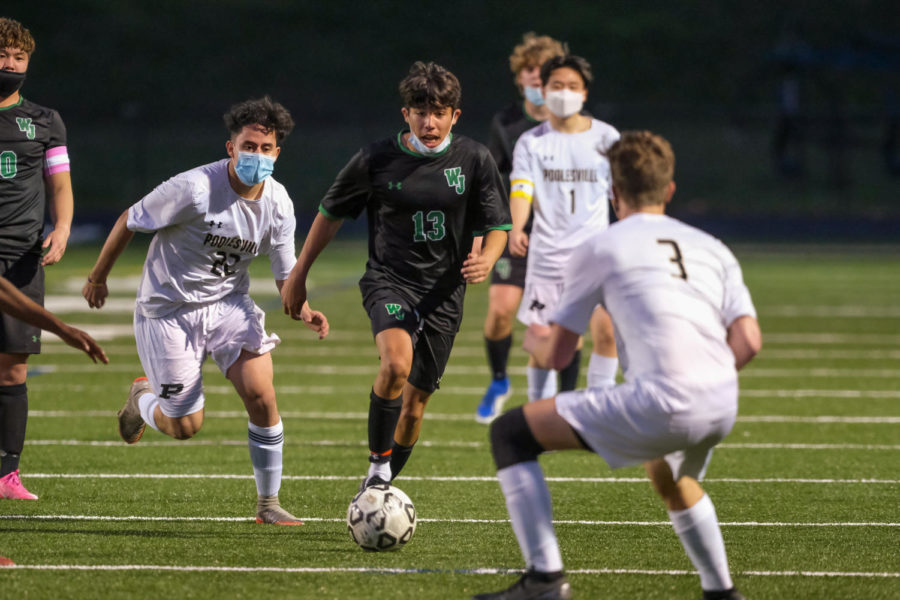 Sophomore Thomas Poliseno dribbles the ball upfield on a counterattack. The Wildcats offensive attack was relentless against Poolesville.