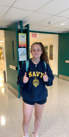 Senior Emma Richardell poses in her Naval Academy sweatshirt on the day of her official commitment. Richardell has been the varsity starter on the WJ girls lacrosse team for 4 years.