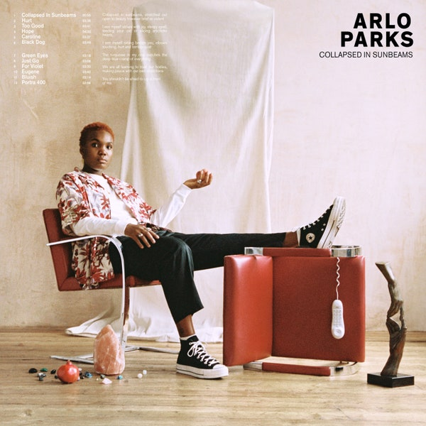 Arlo+Parks%E2%80%99s+debut+album%2C+%E2%80%9CCollapsed+in+Sunbeams%2C%E2%80%9D+was+released+January+29%2C+2021.+Described+as+%E2%80%9Ckind+of+like+bedroom+pop+mixed+with+a+little+bit+of+indie+folk+and+a+little+bit+of+R%26B%E2%80%9D+%28Morning+Edition%29%2C+%E2%80%9CCollapsed+in+Sunbeams%E2%80%9D+has+been+praised+for+Parks%E2%80%99s+revealing%2C+vulnerable+and+relatable+lyrics.